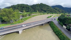Flying closer to bridge over flooding river in Celje Stock Footage