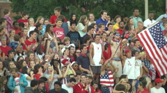 Student section cheering high school football game zoom out Stock Footage
