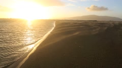 Sunset sand storm on sandy beach and river mouth Stock Footage