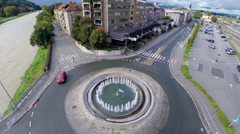 Ascending over roundabout showing cityscape Stock Footage