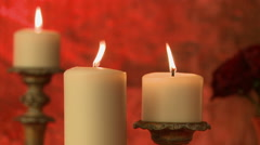 Flickering flame of candles on red background Stock Footage