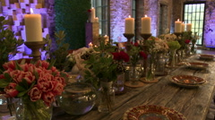 Dining table lavishly decorated with fresh flowers Stock Footage