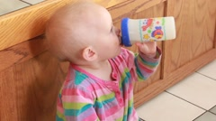 Profile of baby drinking Stock Footage