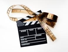 Clapper board with filmstrip Stock Photos