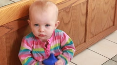 Toddler goes from mild to upset back to mild Stock Footage