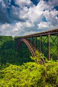 the new river gorge bridge, seen from the canyon rim visitor center overlook, - stock photo