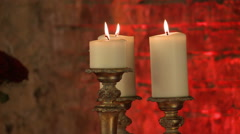 Lighted candles in golden candlesticks, close-up Stock Footage