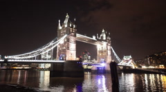 Tower Bridge and the Gherkin by night Stock Footage
