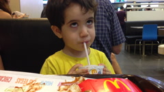 Child acting zombie after happy meal Stock Footage