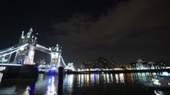 Wide Angle shot of Tower Birdge of London by night from Butlers Wharf Stock Footage