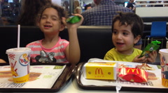 Kids having fun at McDonald's Stock Footage