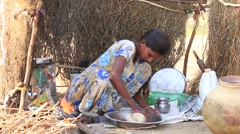 Indian girl prepares chapati outdoor in Thar desert . Rajasthan, Pushkar , India Stock Footage