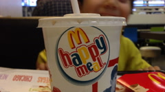 Kids pic soft drink at McDonald's Stock Footage