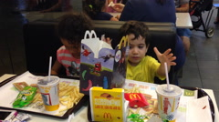 Young children in McDonald's Stock Footage