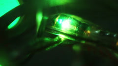 Flashing christmas lightbulb close-up seamless loop Stock Footage