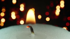 Burning candle and christmas lights bokeh loopable Stock Footage