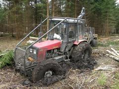Belarus Mtz 1025 forestry tractor got stuck in mud - stock photo