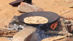Indian chapatti on fire in the desert Stock Footage