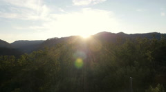 Aerial - Sunset over the hill Stock Footage