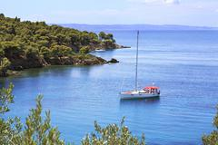 Yacht in the bay of the Aegean Sea. - stock photo