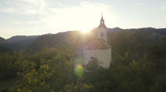 Aerial - Church at sunset amongst trees Stock Footage