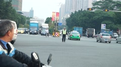 Shenzhen, China: traffic police directing traffic at an intersection Stock Footage