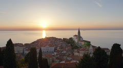 Aerial - Seaside town with city square and church at sunset, Piran Peninsula Stock Footage