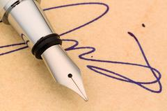 signature and fountain pen - stock photo