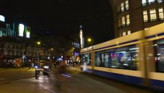 City square evening with traffic, time lapse Stock Footage