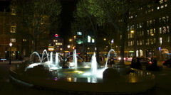 Water fountain at night in city time lapse Stock Footage