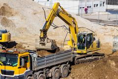 excavator on construction site during earthworks - stock photo