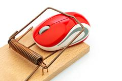 computer mouse in mousetrap - stock photo
