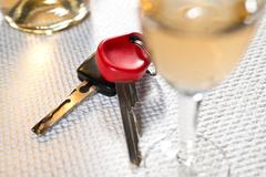 ignition key and hard liquer - stock photo