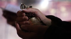 Tibetan buddhistic bell and rosary in hands. Stock Footage