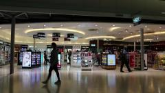 People in duty free area inside Bangkok international airport in Thailand - stock footage