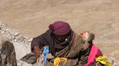 Tibetan pilgrims performing Kailash kora. Stock Footage