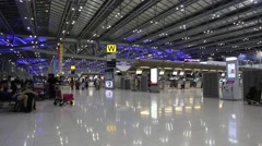 People inside international airport in Bangkok, Thailand Stock Footage