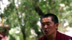 Debating and laughing monk at Sera Monastery, Lhasa Stock Footage