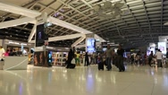 Stock Video Footage of People in duty free area inside Bangkok international airport in Thailand