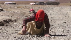 Pilgrim stretches during kora around Lake Manasarovar Stock Footage