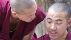 Debating and waving hands monks at Sera Monastery, Lhasa Stock Footage