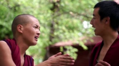 Debating and applausing hands monks at Sera Monastery, Lhasa Stock Footage