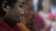 Tibetan monks chanting mantras in monastery Stock Footage