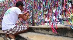 Wall of wish ribbons at the famous Igreja Nosso Senhor do Bonfim da Bahia Stock Footage