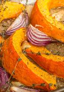 roasted pumpkin with red onion, garlic and thyme - stock photo
