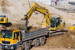 excavator at construction site during excavation - stock photo