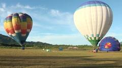 Hot air balloons preparing for flight Stock Footage