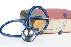 buch und stethoskop, - stock photo