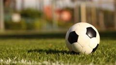 Closeup of a player taking a slide tackle on a ball slide tackle Stock Footage