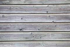 grey planks of old fence - stock photo